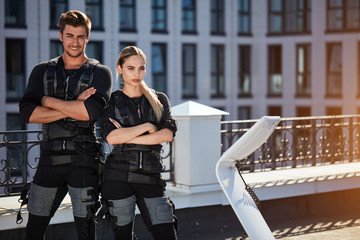 strong sporty man and woman standing with foldered arms and looking at the camera. copyspace.confidence concept