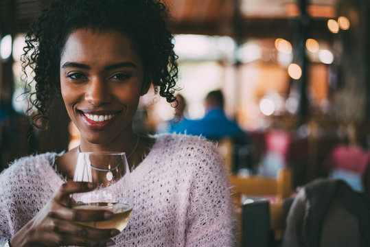 Black woman drinking wine