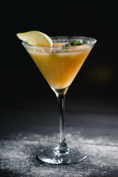 yellow christmas alcohol pear cocktail pear on dark background