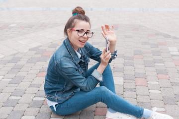 Girl, jeans jacket, fun, smart phone, street