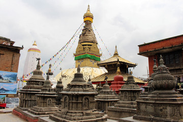 Translation: Around Swayambhunath Stupa (and its eyes) or Monkey Temple of Kathmandu