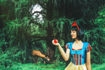 Snow White cosplay girl in the mysterious forest. Artistic processing Fotomurales