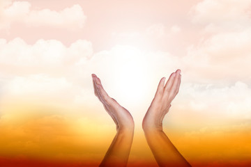 Healing hands in the sky with bright sunburst