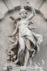 Beautiful topless girl as summit of Sea Power fountain at Saint Michael square at Hofburg Palace in Vienna, Austria, details, closeup