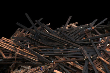 Pile of multicolored scrap wood on a black background