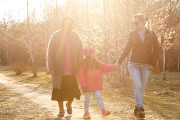 Printed kitchen splashbacks Artist KB Family walking in the park on a sunny day