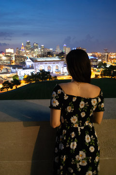 Young woman overlooking city