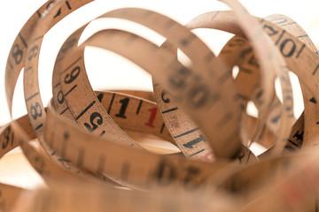 A Vintage measuring tape in loops