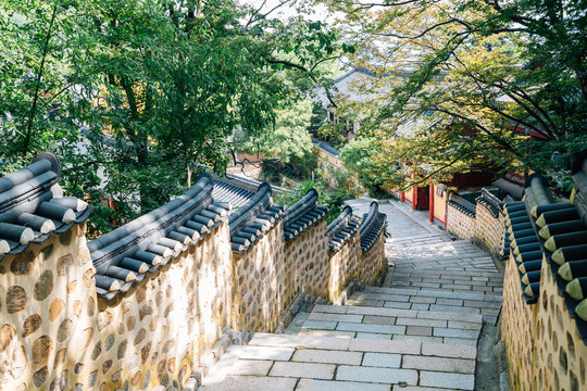Stone wall street and green trees at Beomeosa temple in Busan, Korea