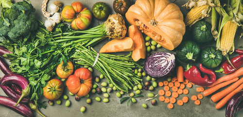 Wall Mural - Healthy vegetarian seasonal Fall food cooking background. Flat-lay of Autumn vegetables and herb from local market over grey concrete background, top view. Clean eating, alkaline diet food