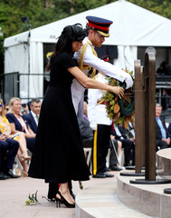 Britain's Prince Harry and Meghan, Duchess of Sussex, place a floral wreath at the opening of the enhanced ANZAC memorial in Hyde Park, Sydney