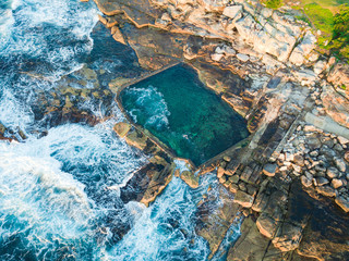 Aerial view of Mahon pool with incoming waves. Maroubra, Sydney, Australia