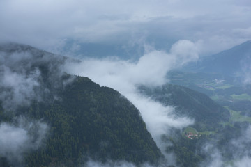 Hills of Dolomites, north Italy with low clouds during summer
