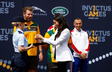 Meghan Markle, the Duchess of Sussex, hands out a medal at the Invictus Games Sydney 2018 Jaguar Land Rover Driving Challenge on Cockatoo Island, Sydney