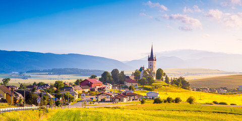 Beautiful landscape of valley in Slovakia mountains, houses in village, rural scene. Spissky Stvrtok, Slovakia
