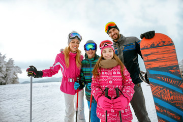 family enjoying winter vacations in mountains. Ski, Sun, Snow and fun