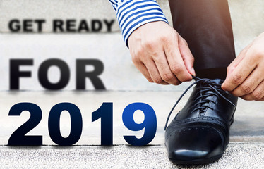 2019 Year Concept, Businessman tie shoelace on the Outdoor Stair, Get ready for new challenge, Lower part