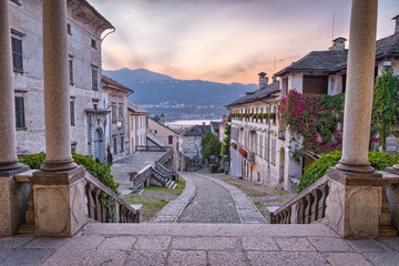Beautiful scenic alley with historic and traditional houses and cobbled street at sunset....