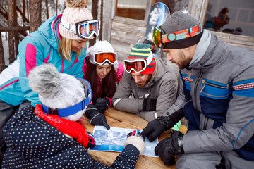 Group of skiers look on map