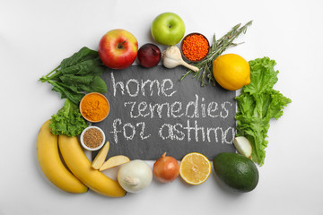 Natural products and slate board with text HOME REMEDIES FOR ASTHMA on white background, top view