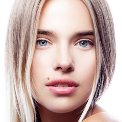 Close-up beauty face of youngmodel girl with healthy clean fresh skin, natural make-up, blond hair, blue eyes. Skincare facial treatment concept