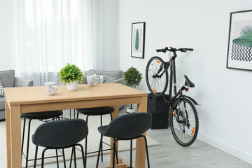 New bicycle near wall in stylish room interior