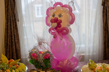 birthday air inflatable doll,on a table a big doll for a birthday