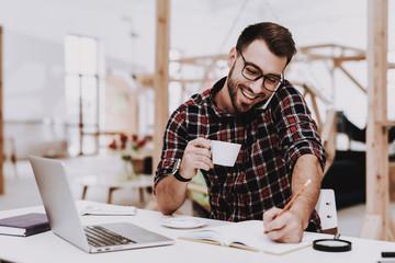 Drinking Coffee. Phone. Laptop. Sit. Brainstorm.