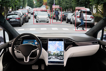 Self driving electric car without driver on a city street. Autonomous mode. Head-up display.
