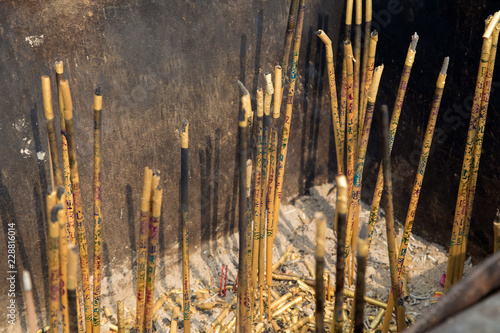 Burning prayer incense at a Buddhist temple  Shot in at an