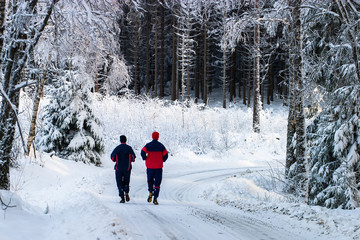 Couple running on a forest road