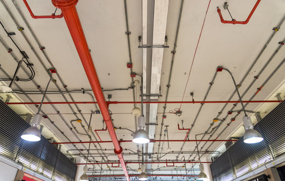 power line in running conduit tube on ceiling, galvanized steel conduit and piping