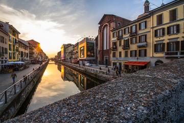 Milan Naviglio Grande at Sunset with Canal Reflection. Navigli District Europe Landmark in Italy