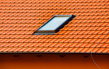 Attic window skylights on the red clay tile roof.