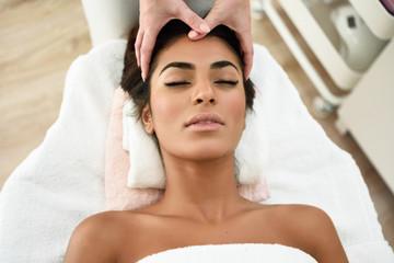 Woman receiving head massage in spa wellness center. Wall mural
