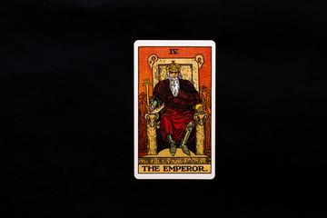Fototapeta An individual major arcana tarot card isolated on black background. The Emperor. obraz
