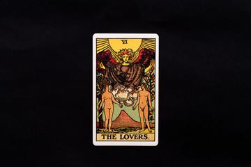 An individual major arcana tarot card isolated on black background. The Lovers.