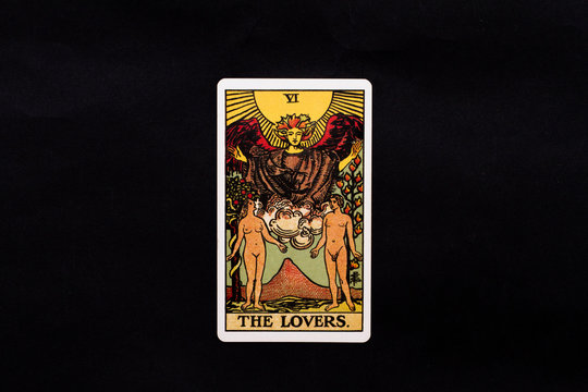 An individual major arcana tarot card isolated on black background. The Lovers.