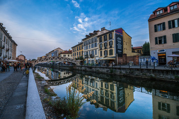 Milan Naviglio Grande at Sunset with Canal Reflection. Navigli District Europe Landmark in Italy