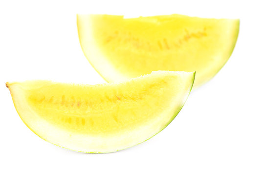 Sliced watermelon with yellow flesh on a white background