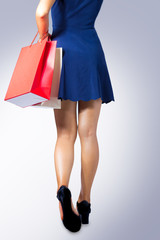 A woman is holding shopping bag.