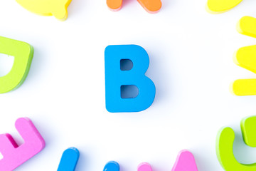 B letters in English made from wood bright colors.