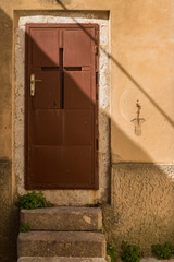 Brown door with a cross