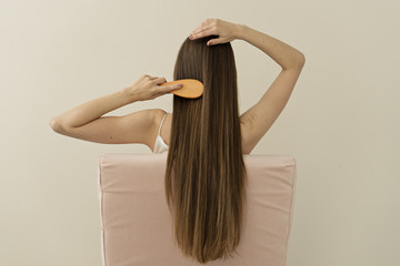 image of attractive woman brushing her  long hair