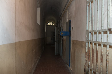 Long Corridor and White and Worn Walls of a Prison