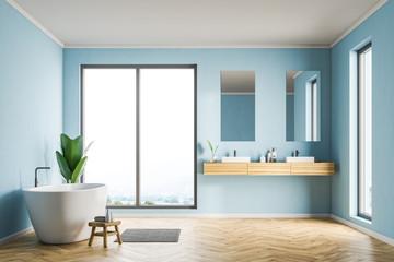 Blue bathroom interior, sink and tub