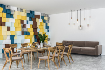 Colorful dining room corner with sofa
