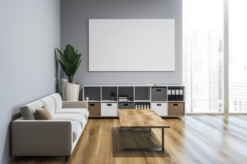 White living room with cabinet and poster, sofa