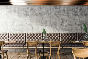 Grunge restaurant interior, brown sofas