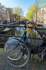 Romantic scenery with bicycles at one of the canals in Amsterdam old town, Netherlands